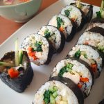 Chicken kimbap rolls with kelp soup in the background