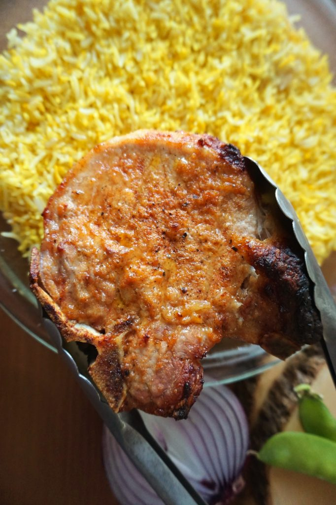Baked Pork Chop over Yellow rice
