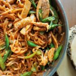 Allergy-friendly chicken Pad Thai in a pan top view