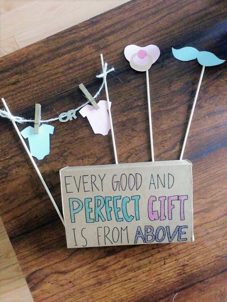 Top view of second trimester gender reveal props