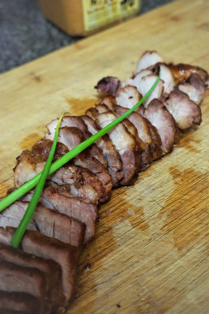 Cantonese barbeque pork cut with green onions on top