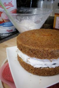 Carrot cake with icing between the two layers
