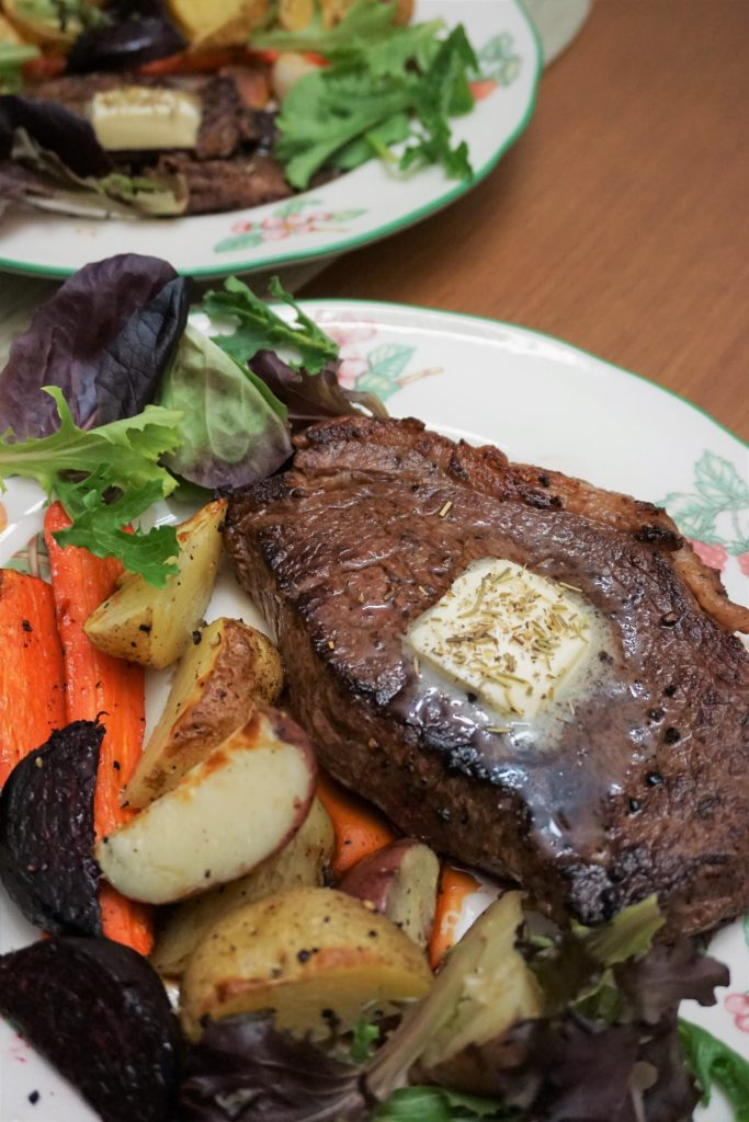 Sirloin steak with roasted veggies in a plate