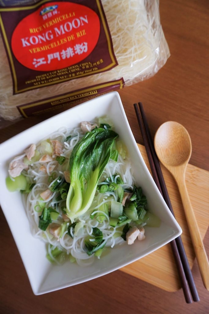Shanghainese noodle soup with tender chicken with vermicelli package on top of picture